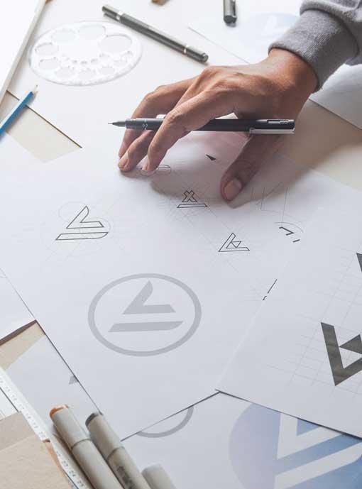 Closeup of logo designer working at desk