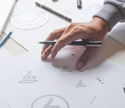 Logo designer sketching with a pencil